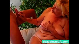 Granny titty fucks her young lover