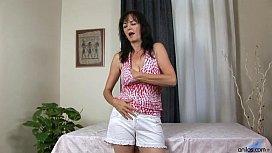 Horny Cougar Rubs Her Busty Tits And Masturbates