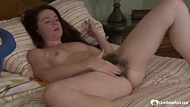 Sexy hairy babe is alone and masturbating