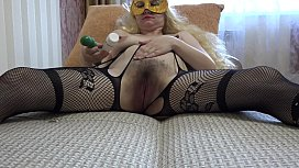 A pregnant milf with a big hairy pussy masturbates on the couch.