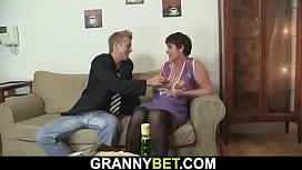 Hunky dude fucks her hairy old pussy