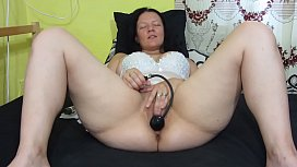 Chubby milf fingering hairy pussy, with inflatable dildo stretching and fucking vagina, licks her orgasm juices. Home masturbation and gaping cunt.