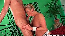 Grandma in white stockings enjoys his hard cock