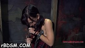 Bounded beauty is dripping moist from her sexy torture