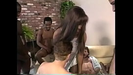 African babe Sharon Bell likes different cocks in her mouth while getting her pussy fucked