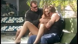Sexy young blonde gets her tight twat pounded by two hung studs outside