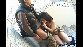 Naughty Japanese brunette enjoys sucking a fat dick in public
