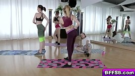 Yoga teens tag team for a huge cock taking turns sucking it!