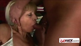 Hairy cunt granny sucks a dick while fingering before riding.