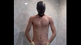 guy wanks in condom and medical gloves