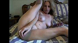 Blonde mature toys herself on webcam