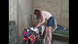 Young hot girl fucks the old horny neighbors in the workshop.