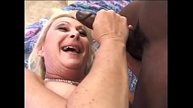 Mature blonde lady Anastasia Sands warms up her her bushy twat waiting for big black dong of her younger lover