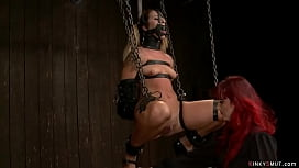 Gagged and chained lesbian gets whipped