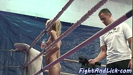 Lotioned babes wrestling in a boxing ring