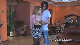 Master uses a rubber band to punish his slave girl.
