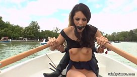Blonde domme takes brunette in a boat