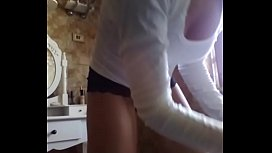 a housewife with impressive nipples, teases you while she cleans thoroughly