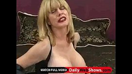 Mature milf with excellent body plays with a dildo and rubs her huge tits - DailyWebShows.com
