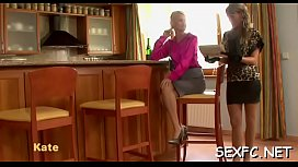 Sexually excited women sharing the dick while clothed in their kitchen