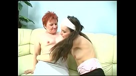 Redhead MILF Kate gets down eating wet pussy on the sofa