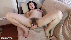 Liza James loves to play with her hairy pussy