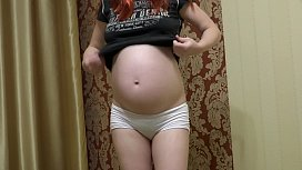 Pregnant milf in white panties finished fitness with an orgasm. Sex toy in a hairy pussy doggystyle.