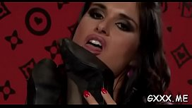 Nice-looking lesbian engages in some hot kissing and dildo play