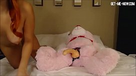 hot red haired fuck rides giant teddy bear