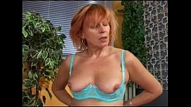 Redhead mature'_s doing herself