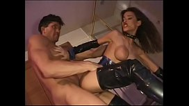 Fake boobs bruunette in latex boots gets pussy pumped with cock