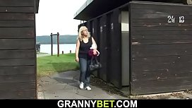 Busty blonde granny takes cock in the changing room