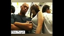 Guy pressing Girl'_s Boobs in the running Bus