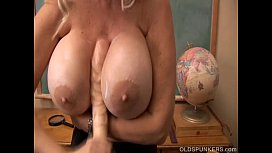 Busty old spunker teaches you how to fuck her massive tits