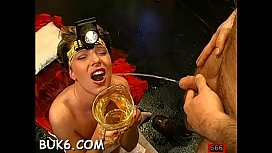 Lovely babe'_s mouth is filed with ball batter during blow bang
