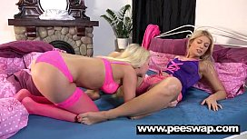 Two cute blondes get friendly and piss