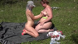 Two lesbians with big asses and one strapon have fun outdoors. Orgasm in the clearing.