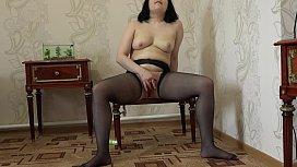 Anal masturbation. Brunette doggystyle fucks juicy ass in pantyhose.