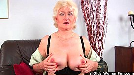 Grandma in stockings massages her big tits and old pussy