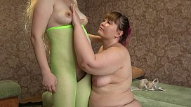Milfr at an early stage of pregnancy having fun with a lesbian. Girlfriend spanked juicy ass and fucked hairy pussy.