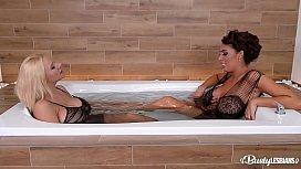 Busty lesbians Ava Koxxx &amp_ Dolly Fox fill their wet pinks with glass dildo