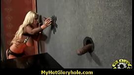 Sucking a big black cock through a gloryhole 9