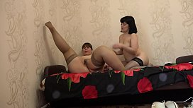 We with the girlfriend lick each other hairy pussy, hot oral caresses of two lesbians in stockings.