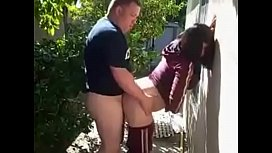 Horny milf fucking neighbor behind her house