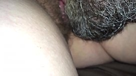 licking wife'_s hairy pussy while she s.