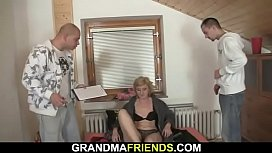 Old blonde riding and sucking at same time