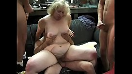A group of guys fuck the horny blonde woman in orgy