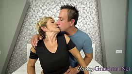 Horny blonde granny blows hard cock