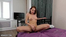 Candy Red fingers her fiery hairy pussy
