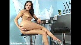 Petite European brunette filling her tight pussy with a giant dildo